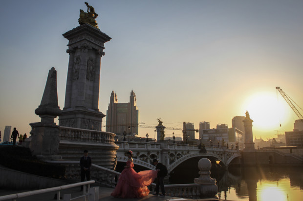 A Bride Prepares for Wedding Photos in Front of the Italian Bridge, Tianjin. Photo Credit: N. McGee