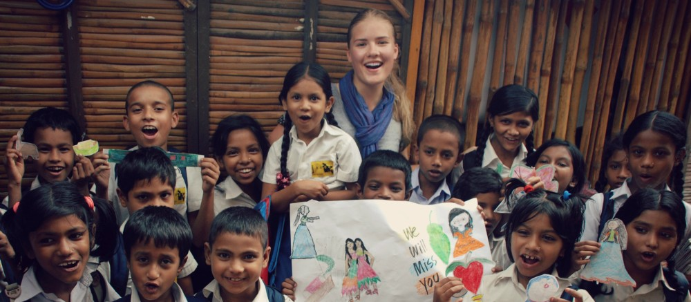 Canadian student enjoying her experience abroad with children
